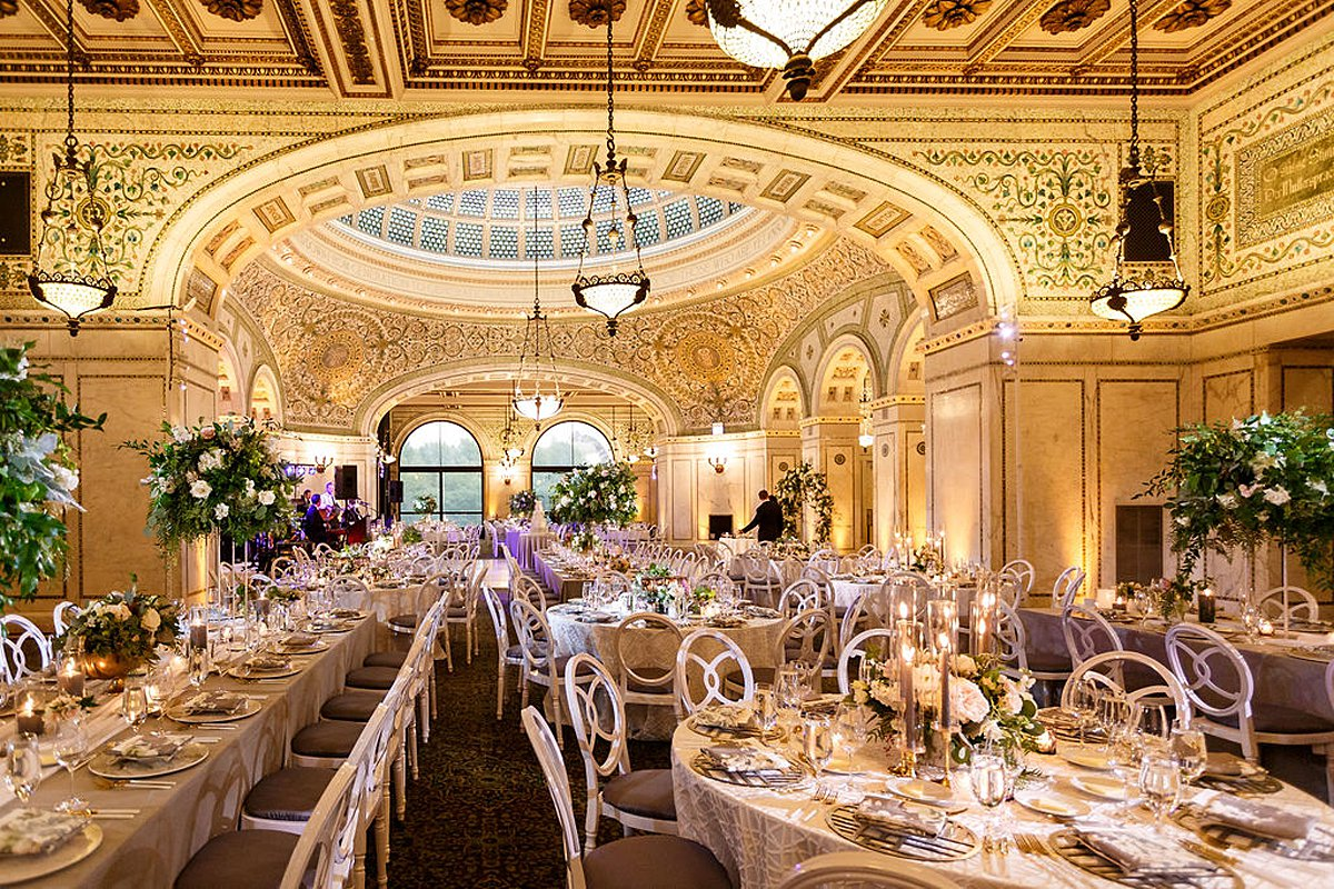 Beautiful reception at Cultural Center in Chicago, featuring various centerpiece heights