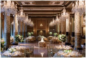 Wedding Reception with whites and greens in tall and low centerpieces